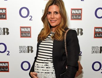 Pregnant Zoe Hardman attends O2 War Child gig with Jessie Ware